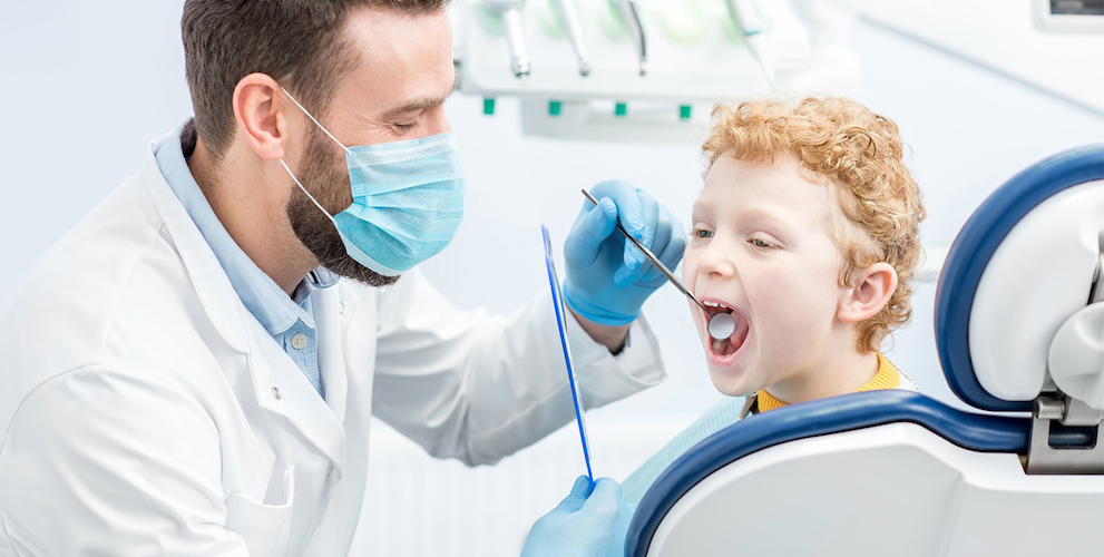 Dentist examining child
